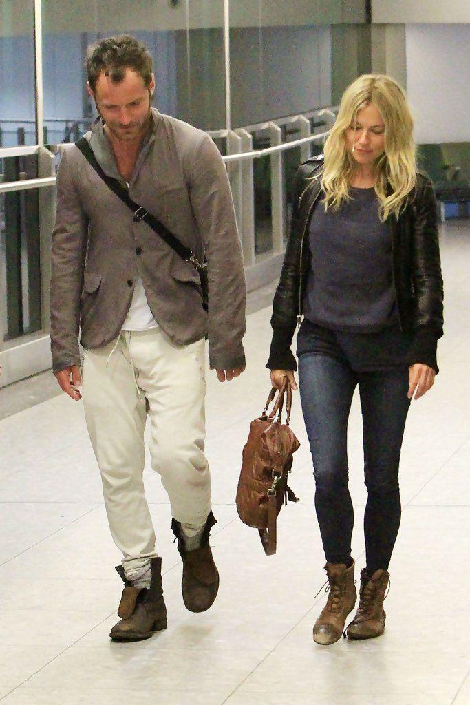 Sienna Miller - Jude Law and Sienna Miller at Heathrow Airport