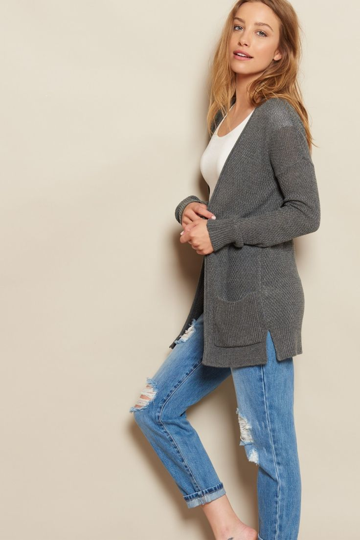 Stay cozy! When the temps dip, warm up with this knitted super soft cardigan, featuring side slits and pockets.