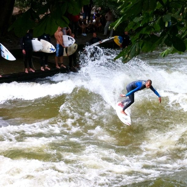 Eisbach Surfer Wave, Munich, Germany - River Surfing in Munich ! The Eisbach, an artificial stream that runs through the English Garden which is Munich's largest public park. This surf wave is located at the southern edge of the park, next to the Haus der Kunst.