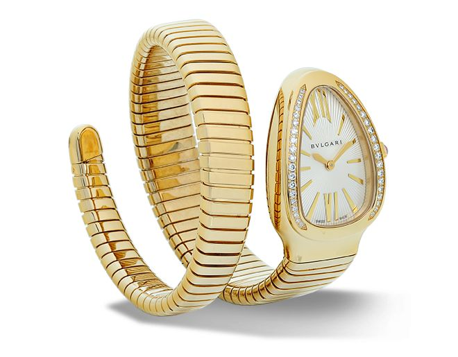 Quartz movement. 35 mm 18-ct yellow gold curved case set with brilliant-cut diamonds. 18-ct yellow gold crown set with a cabochon-cut pink rubellite. Silver opaline dial with guilloch