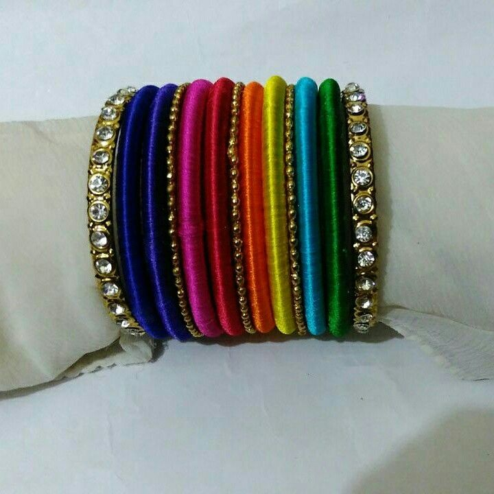 Silk thread multicolour bangles .. Orders undertaken.. Colours can be customized.. To order whatsapp 8790245879