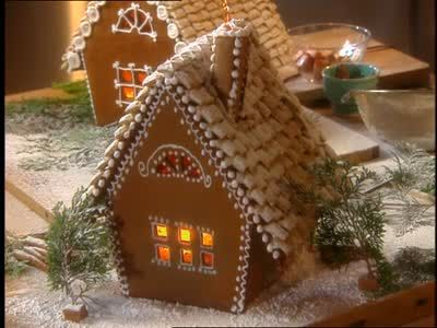 Martha Stewart makes a magnificent gingerbread cottage out of caramelized sugar, gingerbread, and other delightful sweets.