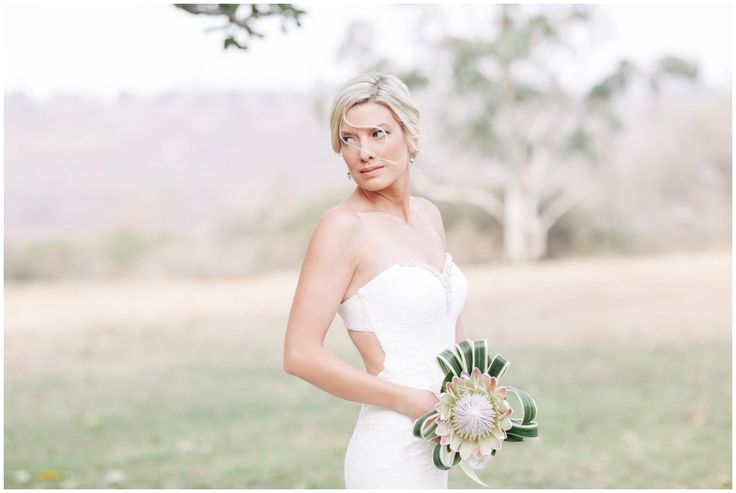 www.vanillaphotography.co.za | Durban wedding photographer, Tala Game Reserve, Durban wedding venue, game lodge, safari wedding, bride, white lace, open back wedding dress, sexy wedding dress, protea bouquet.