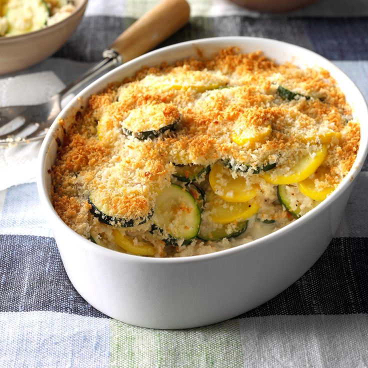 Yellow Squash and Zucchini Gratin Recipe -This gratin is the perfect way to use up an abundance of summer squash. It's easy to prepare, takes just 10 minutes in the oven, and serves up bubbly and delicious. —Jonathan Lawler, Greenfield, Indiana