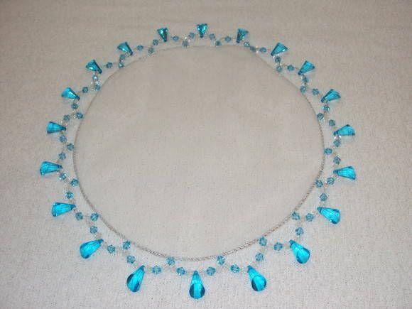 Cobre jarra em tule com pedraria azul turquesa - diametro 25 cm. <br>Pode ser confeccionado também em outras cores de pedraria a escolher.