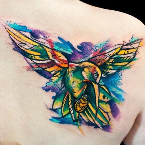 Watercolor tattoo (4) - bird back tattoo on TattooChief.com