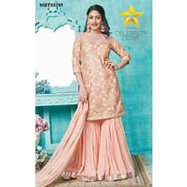Peach Embroidered Gharara Set Invoke out your begum side with the soft peach embroidered gharara set by Meena Bazaar. Handcrafted in net with all over gotta handwork highlighting. It is paired with gharara based on georgette with gota border.Immaculately Handcrafted tassel adding extra charm to the beauty of the gharara set.The dupatta is crafted in net and embellished with gota patch work. Kundan jewelry will go a long way in complementing this exquisite attire.