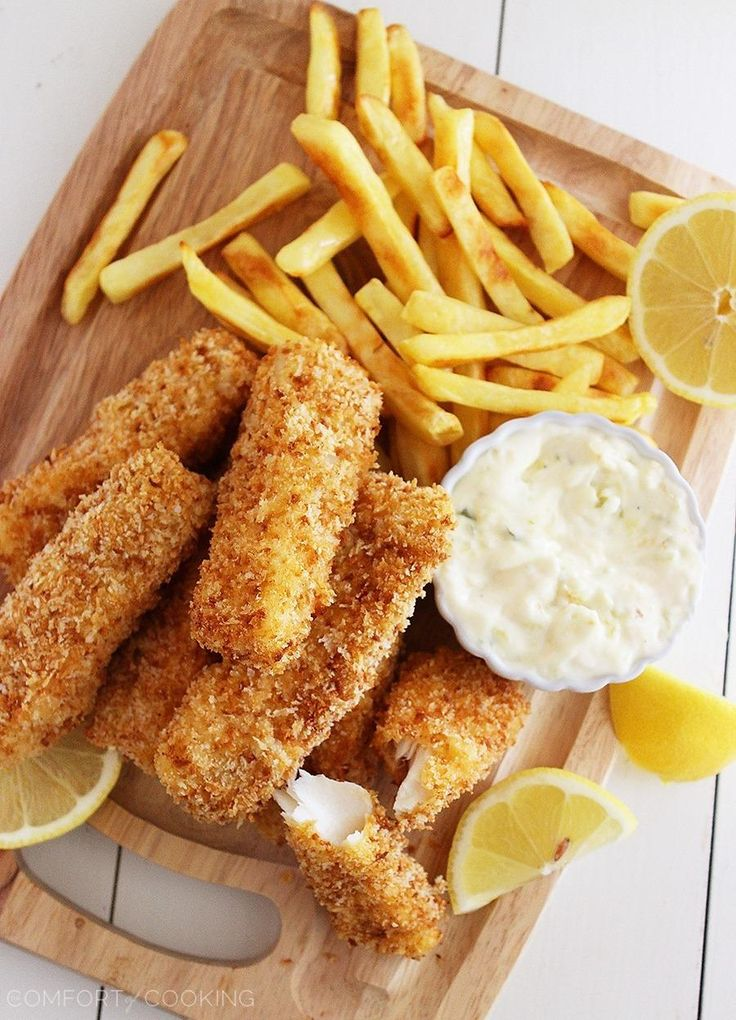 The most amazing, delicious, baked fish sticks with tartar sauce. Pro tip: swap mayo for Greek Yogurt.