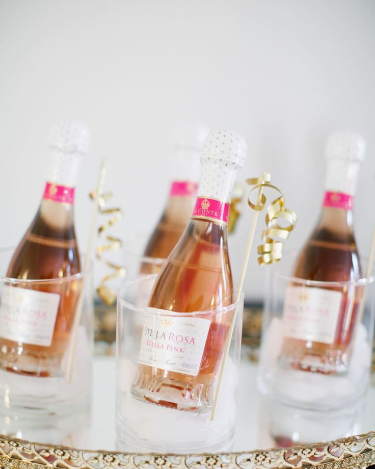 Tape curled ribbon to the top of bamboo sticks for glamorous party libations. Julie Blanner tells you how.