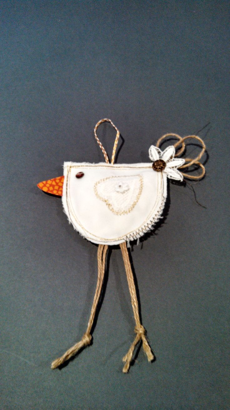 Partridge ornament- heirloom lace, vintage button and jute by Catherine Smith.