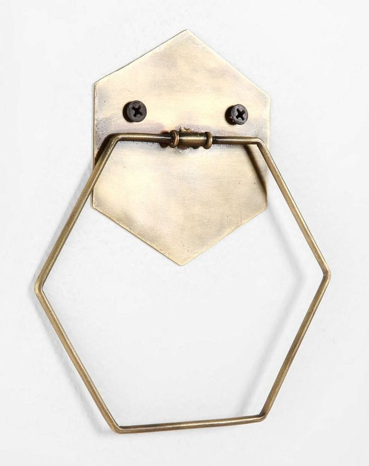 """Hexagonal towel ring crafted from antiqued metal Predrilled holes for easy placement Complements almost any décor Towel not included UO Exclusive 5""""l, 6.5"""""""