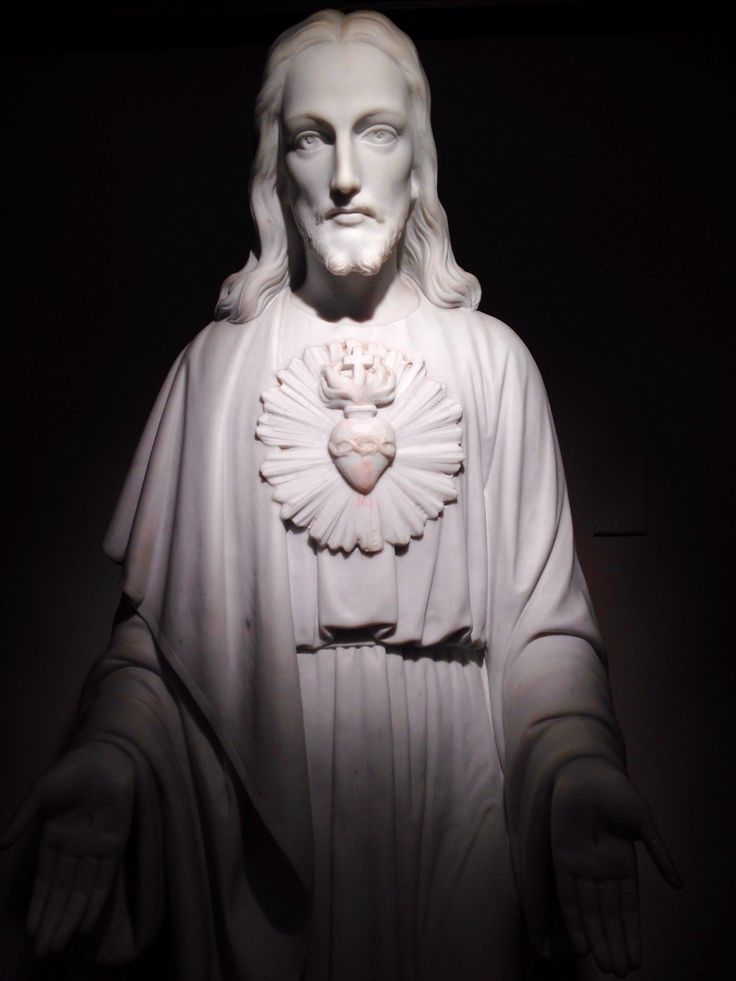 I go to this parish all the time for Daily Mass. Today, leaving the pew, the Sacred Heart statue caught my eye. I completely it was there :) Side note: I noticed a red smudge on His heart. I looked...