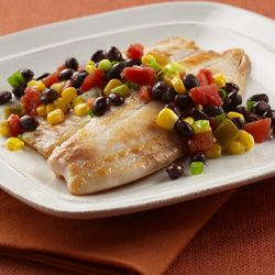 Tilapia w/Black Beans & Corn. Combine 1 can black beans, drained & rinsed, 1 can Rotel, drained, 1 cup frozen whole kernel corn, 1/3 cup sliced green onions, 2 T oil, 1 T cider vinegar. Season fillets with salt, place in med-high skillet, cook 3 min, turn over, cook 2-3 min more until fish flakes easily. Transfer to serving platter and top each w/about 3/4 cup bean-corn mixture. I think I'll use Cajun seasonings instead of salt and add a cilantro-chipotle dressing.