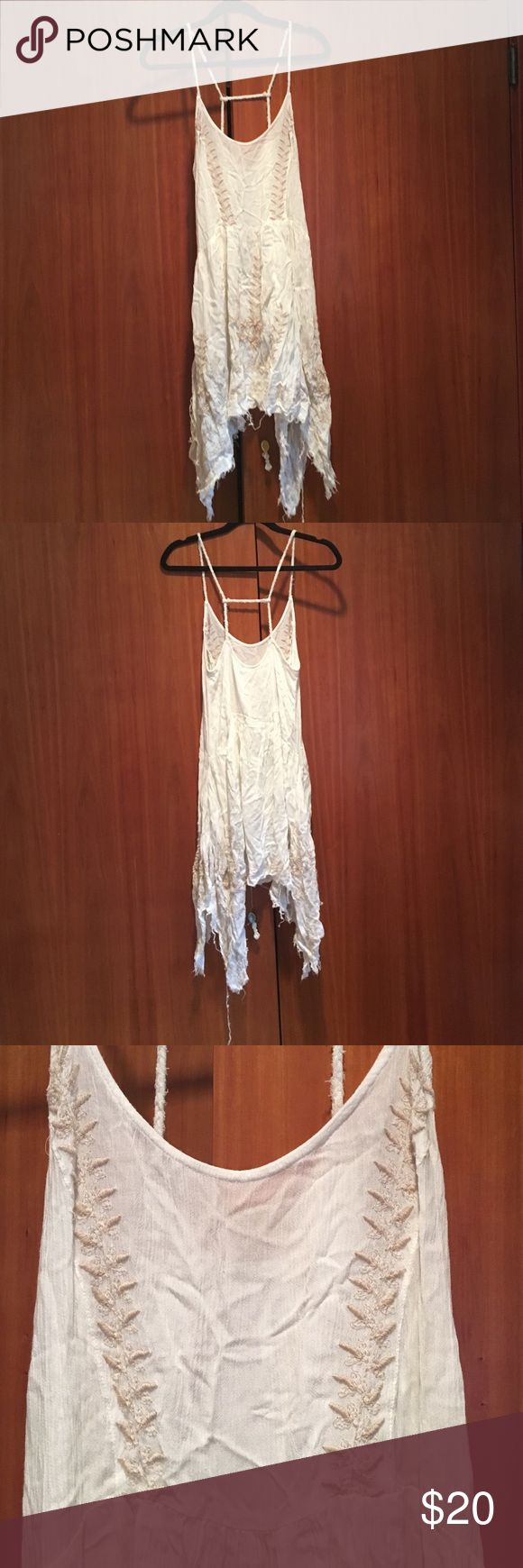 Size 0 white dress in the ocean