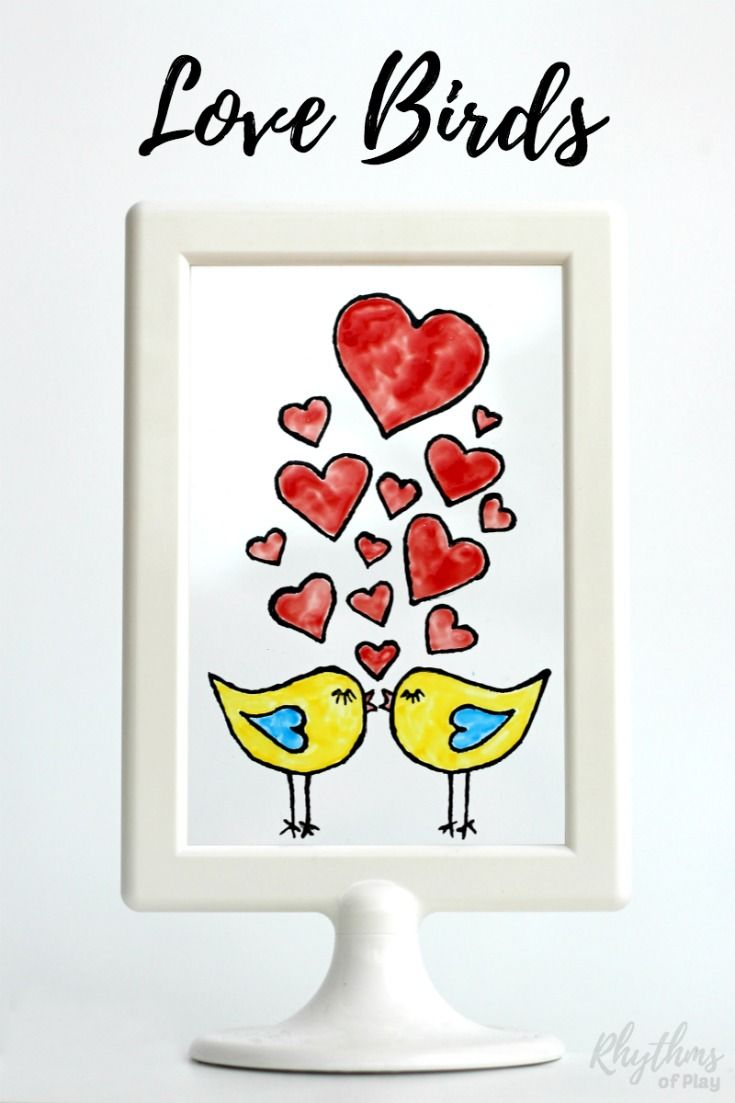 These DIY hand painted stained glass love birds would make a great homemade gift idea for Valentine's Day, weddings, and anniversaries. Click through to download the free printable template and learn how easy it is to create stained glass art windows and