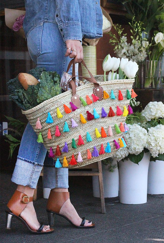 Dress up a straw tote with DIY tassels.