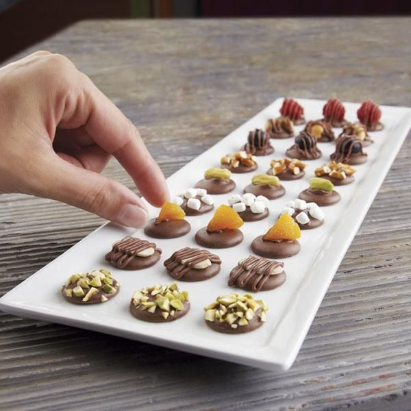 Simply Sweet Candy Melts Candy Treats - Let Wilton Candy Melts candy give you a leg up in creating these simple, yet elegant treats. So easy, yet so very pretty, these candy treats are crafted of a softened Candy Melts candy wafer and topped with a variety of delicious goodies.