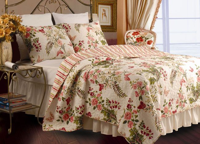Update your bedroom with floral king size quilt sets like this charming cotton quilt and shams set. This stylish set features a dreamy floral print in elegant feminine hues, playful coordinating stripes to the reverse, and colorful matching pillows.
