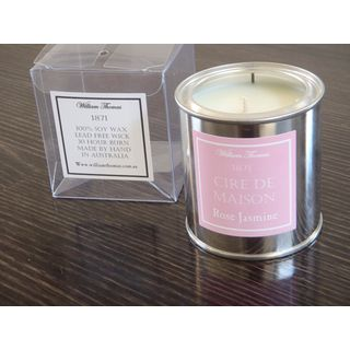 An artistically packaged, scented candle in a bright tin can - perfect for the present that needs to be sent in the  mail!  The candle is made from soy wax and has a lead free wick.