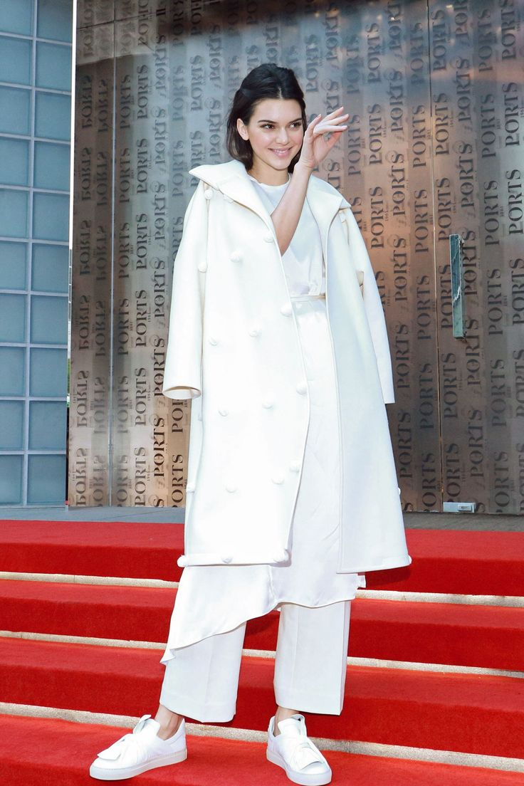 The model attends the Ports 1961 Spring 2016 presentation at Shanghai Fashion Week wearing a head-to-toe white look, featuring a longline top and cropped trousers layered under an oversized coat, plus casual sneakers.    - HarpersBAZAAR.com