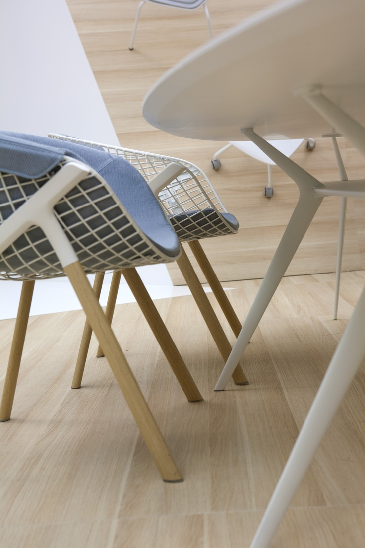 Alias stand Salone del Mobile 2013. Kobi dining chair with oak legs and Biplane table in white