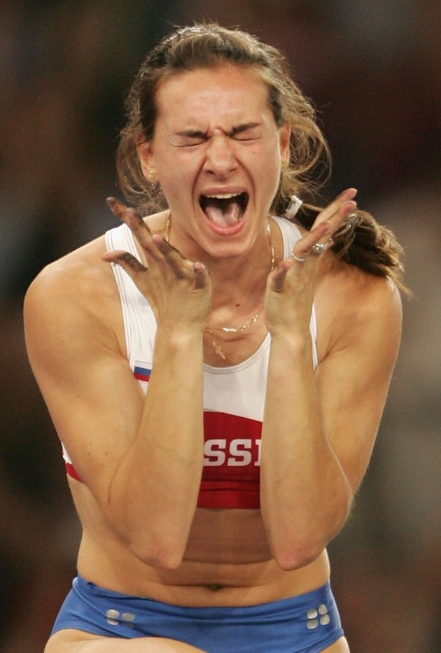 Yelena Isinbayeva celebrates after she completed a world record attempt (4.91m) in the women's pole vault final during the Athens 2004 Summer Olympic Games at the Olympic Stadium (Photo by Mark Dadswell/Getty Images)