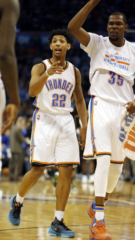 Oklahoma City Thunder's Cameron Payne (22) and Kevin Durant celebrate play during the second half of an NBA basketball game in which the Oklahoma City Thunder defeated the Milwaukee Bucks 131-123 at Chesapeake Energy Arena on Dec. 29, 2015 in Oklahoma City, Okla. Photo by Steve Sisney, The Oklahoman