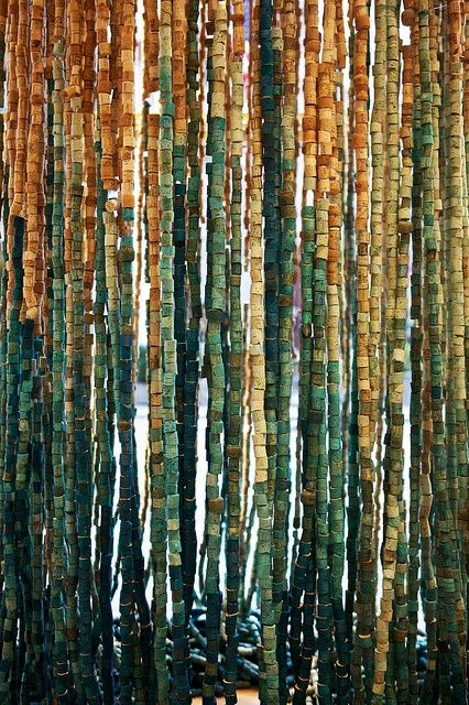 Corks-this blog pretty much has all the best cork ideas. I saw this one and thought it was a picture, but it's a curtain. I think I still may make this in a frame. It looks like bamboo or tree trunks.