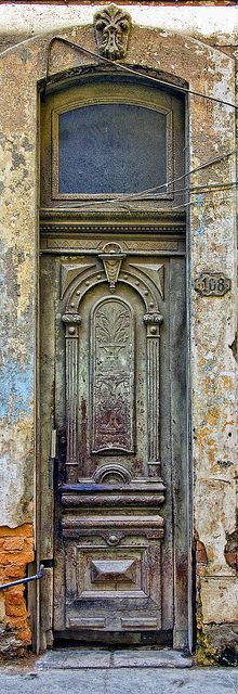 Magnificent front door that was splendid, but today is so badly injured, chipped and faded island of Cuba ...