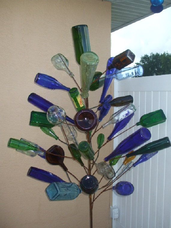 """The """"Mac Daddy"""" Glass Bottle Tree Holds 43 Bottles"""