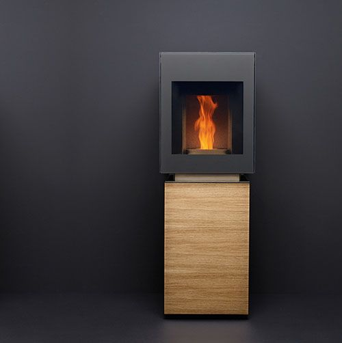 Modern Pellet Stove by Gabaan. Burns sawdust pellets from untreated wood, has low emissions and virtually no burn residue. The lower compartment attractively covered to look like. Piece of furniture, is the place to put in the pellets. It turns on and off with a touch of a button. The upper compartment has windows on three sides so the fire is visible from all sides.