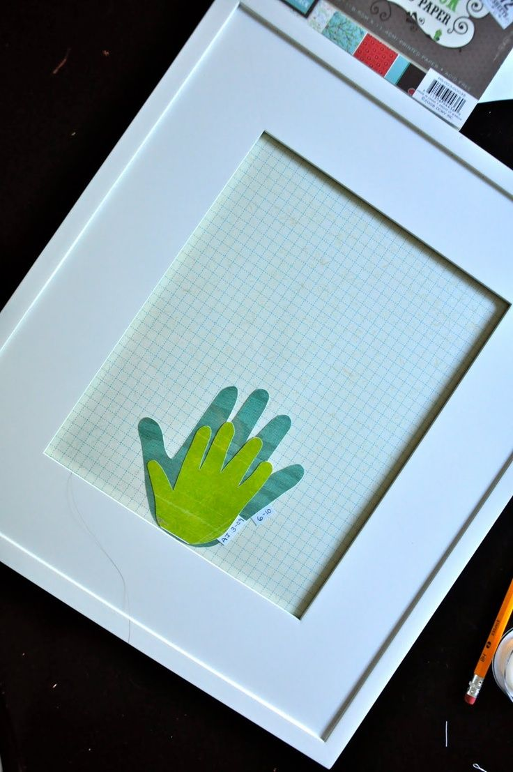Trace your childs hand at every birthday and see it grow. Glue one to the other, but do not glue them down to the mat. (That way you can add next years hand to the back).