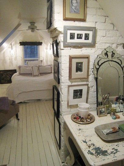 Attic bedroom. White painted wooden floors.