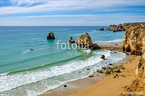 Famous Portuguese destination in Lagos, Algarve. Pinhao Beach and Dona Ana beach aerial view. Colorful seascape, Summer Holiday