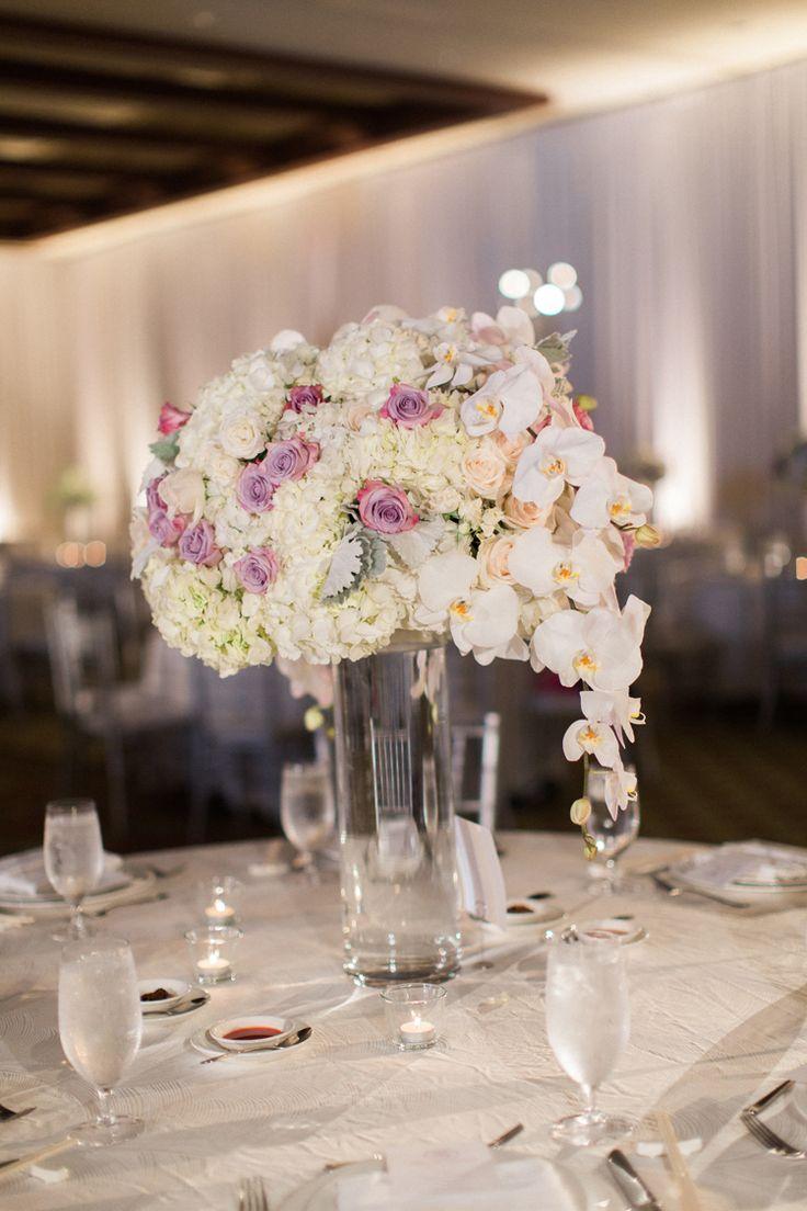 Elegant tall wedding centerpiece with orchids and hydrangea (Caroline Tran Photography)