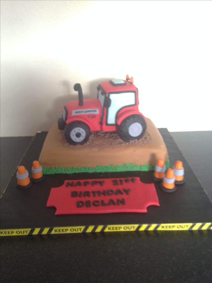 Tractor cake that I made recently with a Massy tractor sitting on a pile of dirt