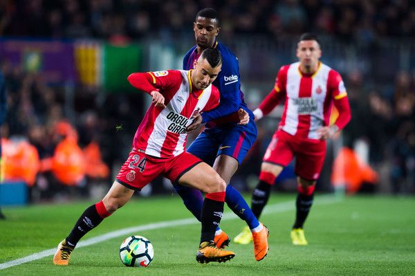 Borja Garcia of Girona FC and Nelson Semedo of FC Barcelona fight for the ball during the La Liga match between Barcelona and Girona at Camp Nou on February 24, 2018 in Barcelona.