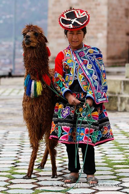 The Quechua girl and the Llama - Peru.