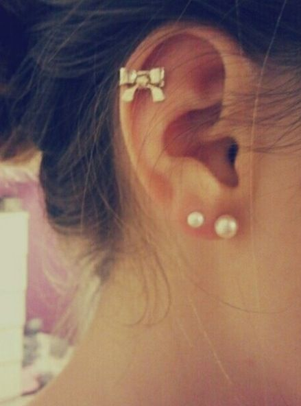 the bow for the cartilage piercing is too cute! I want that piercing too....