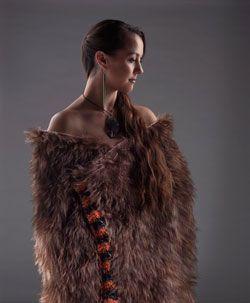 Atareta Te Rangimārie Sciascia wears a kahu kiwi (kiwi-feather cloak) named Pīata