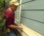 Replacing water damaged hardboard siding with durable fiber cement siding.