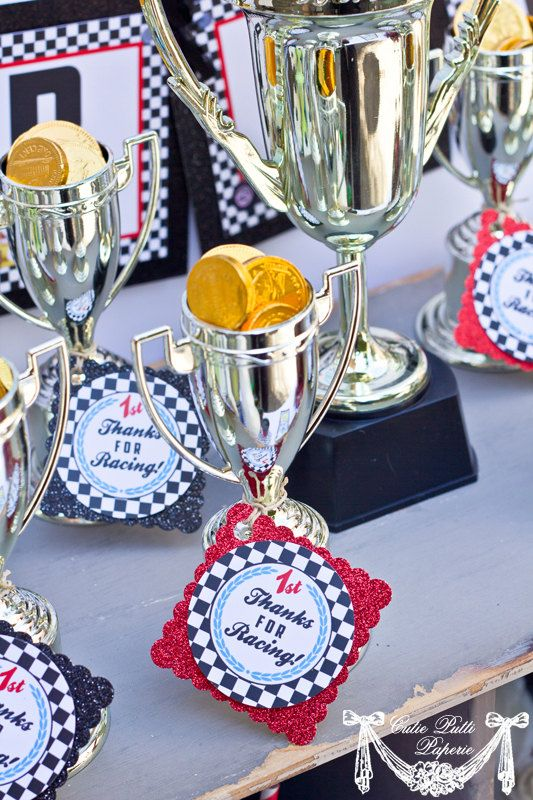 This is cute party favor. I bet dollar tree or Hobby lobby has the trophies and chocolate coins.Race Car Party Vintage Race Car Birthday  2inch by CutiePutti, $5.50