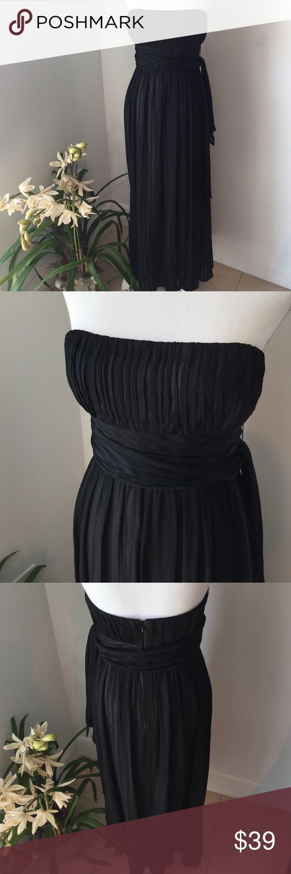 """Gorgeous floor length strapless black dress sz 10P Gorgeous sheer black dress with beige lining. The outside has a very subtle sheer stripe through it which allow the beige to be visible.  Strapless bandeau top with heavy rubber interior finish. Measures 18"""" at bandeau top, 5 inch bandeau band, 15 inches at empire waist, a line skirt so no hip measurements and 47 inches (approximate) from bandeau top underarm to exterior hem. Size 10 Petite BCBGMaxAzria Dresses Maxi"""