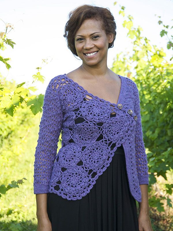 This fabulous crocheted cardigan features floral motifs on one side and a latice stitch on the other. The two sides are beautifully joined at a slant on the back.    This free pattern is available exclusively as a print-friendly PDF file - it's easy to read and requires less paper when printed. To download the pattern, just click the PDF link above.  Trouble getting the PDF? Make sure you've downloaded the latest version of the free Adobe Reader software.