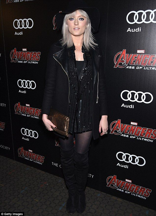 Pretty in platinum: British fasion model Sophie Sumner let her light tresses down as she w...