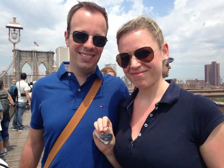 """New York, Brooklyn Bridge: Sweethearts Krissie Walder and Dirk Schneider from Germany clipped a heart-shaped lock with their names engraved. """"It's a sign of our love,"""" said Krissie Walder, 31, before she clipped a heart-shaped lock to the 131-year-old bridge. """"As long as this bridge is standing, our love will be too."""""""