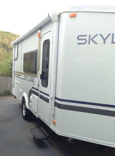2011 Used Jayco Skylark SKYLARK 21FKV Travel Trailer in Colorado CO.Recreational Vehicle, rv, 2011 Jayco Skylark SKYLARK 21FKV, Lightweight, roomy travel trailer that has amazing wood and upholstery finishes inside. Great kitchen in front with lots of storage. Has 5 cu. ft. refrigerator (gas/elec), two burner gas stove, microwave, bath w/shower in back corner and vanity outside the bathroom, wardrobe closet and overhead cabinets above bed, dinette and sofa. Beautifully maintained and clean…