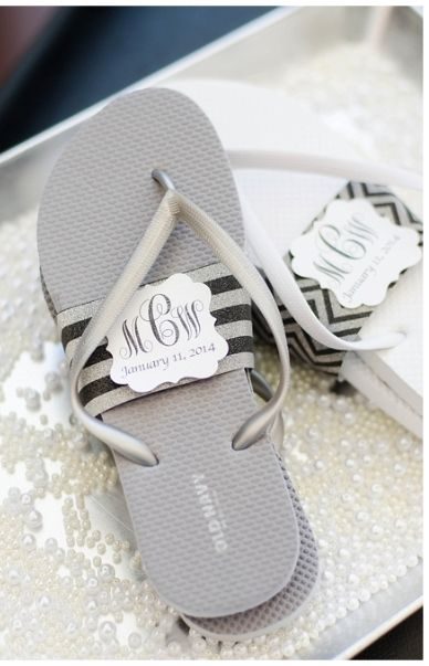 old navy flip flops wrapped in band with couples monogram as wedding guest favors dancing
