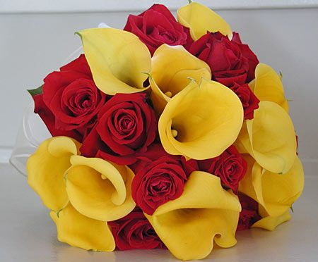 "The perfect bouquet for a Cyclones wedding. Photo via eventseasy. - ""Category #1 -Cardinal and Gold"""