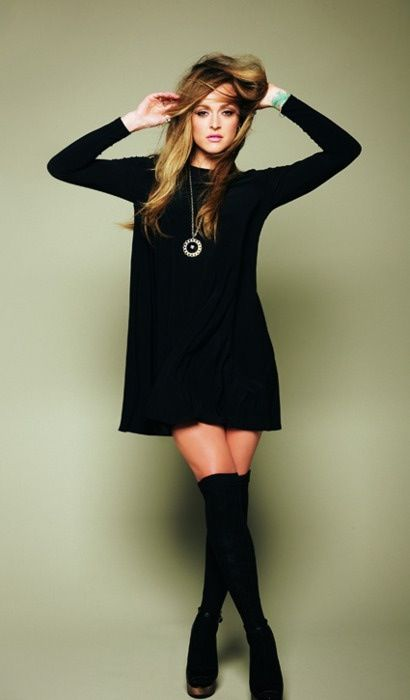 Black long sleeved dress, necklace and knee-high socks. Wednesday Adams never looked cooler.